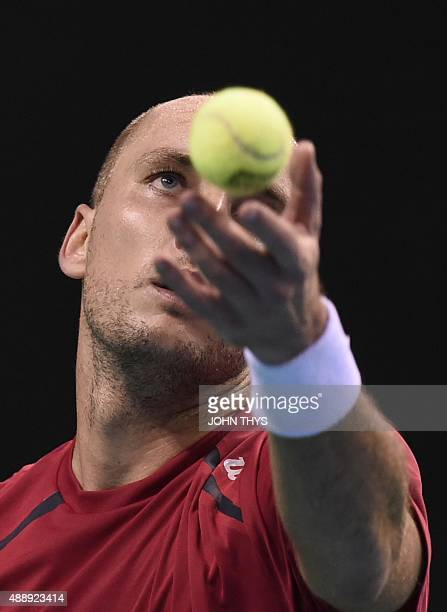 Steve Darcis of Belgium serves during the Davis cup semi-final match against Leonardo Mayer of Argentinia at the Forest National Arena on September...