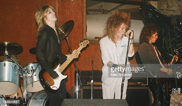 Steve Darrow Axl Rose and Slash of the rock group 'Hollywood Rose' perform at Madame Wong's on June 16 1984 in Los Angeles California