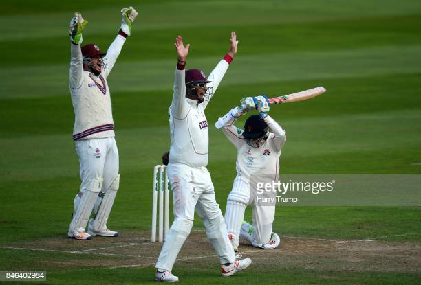 Steve Davies and Marcus Trescothick of Somerset appeal for the wicket of Shiv Chanderpaul of Lancashire during Day Two of the Specsavers County...