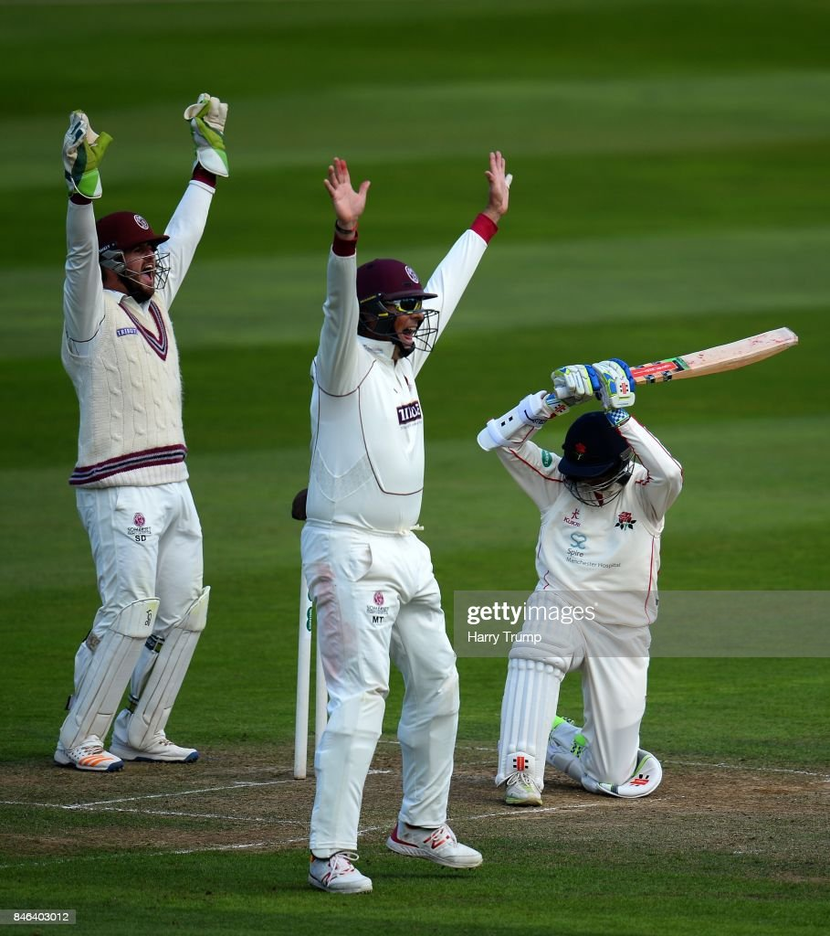 Steve Davies and Marcus Trescothick of Somerset appeal for the wicket of Shiv Chanderpaul of Lancashire (R) during Day Two of the Specsavers County Championship Division One match between Somerset and Lancashire at The Cooper Associates County Ground on September 13, 2017 in Taunton, England.