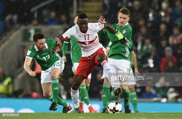 Steve Davis and Corry Evans of Northern Ireland and Denis Zakaria of Switzerland during the FIFA 2018 World Cup Qualifier PlayOff first leg between...