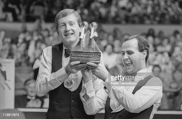 Steve Davis and Tony Meo with the trophy after winning the snooker World Doubles Championship at the Derngate Centre Northampton 14th December 1987