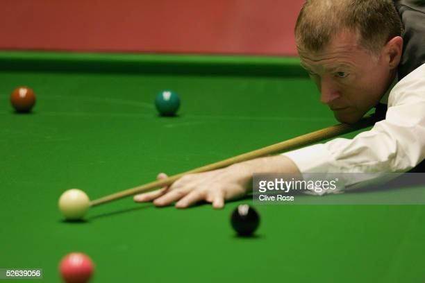 Steve Davis in action during his first round match against Gerard Greene at the Embassy World Snooker Finals at the Crucible Theatre on April 16 2005...