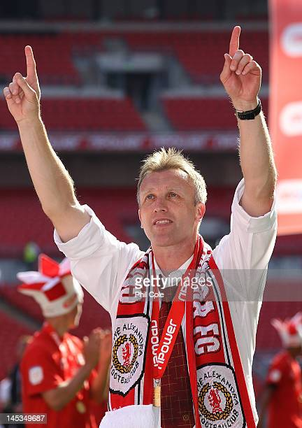 Steve Davis manger of Crewe Alexandra celebrates after victory and promotion at the end of the npower League two playoff final between Cheltenham...