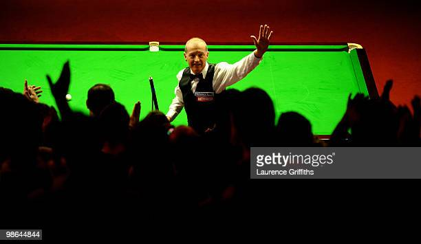 Steve Davis of England celebrates victory in his match against John Higgins of Scotland during the Betfred.com World Snooker Championships at the...