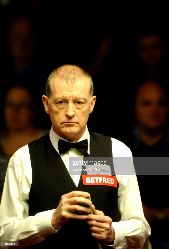 Steve Davis of England eyes up a shot in his match against John Higgins of Scotland during the Betfred.com World Snooker Championships match at The Crucible Theatre on April 23, 2010 in Sheffield, England.