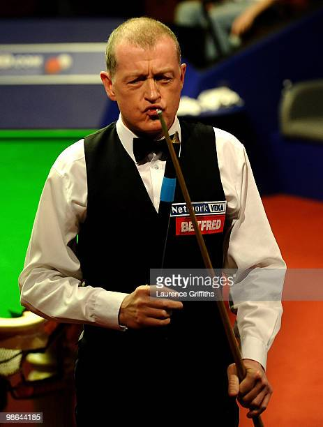 Steve Davis of England gestures in his match against John Higgins of Scotland during the Betfred.com World Snooker Championships at the Crucible...