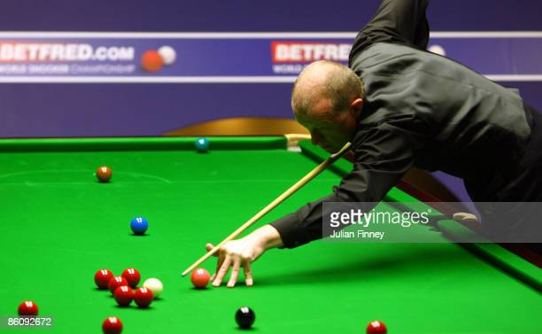 Steve Davis of England in action in his first round match against Neil Robertson of Australia in the Betfred World Snooker Championships at the...