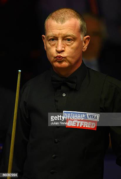 Steve Davis of England looks on in his first round match against Neil Robertson of Australia in the Betfred World Snooker Championships at the...