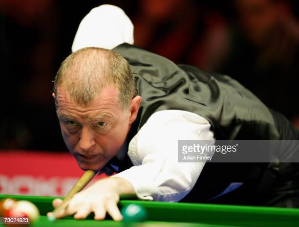 Steve Davis of England plays a shot in his match against Shaun Murphy of England during the 2007 Saga Insurance Masters Snooker at Wembley Arena on...