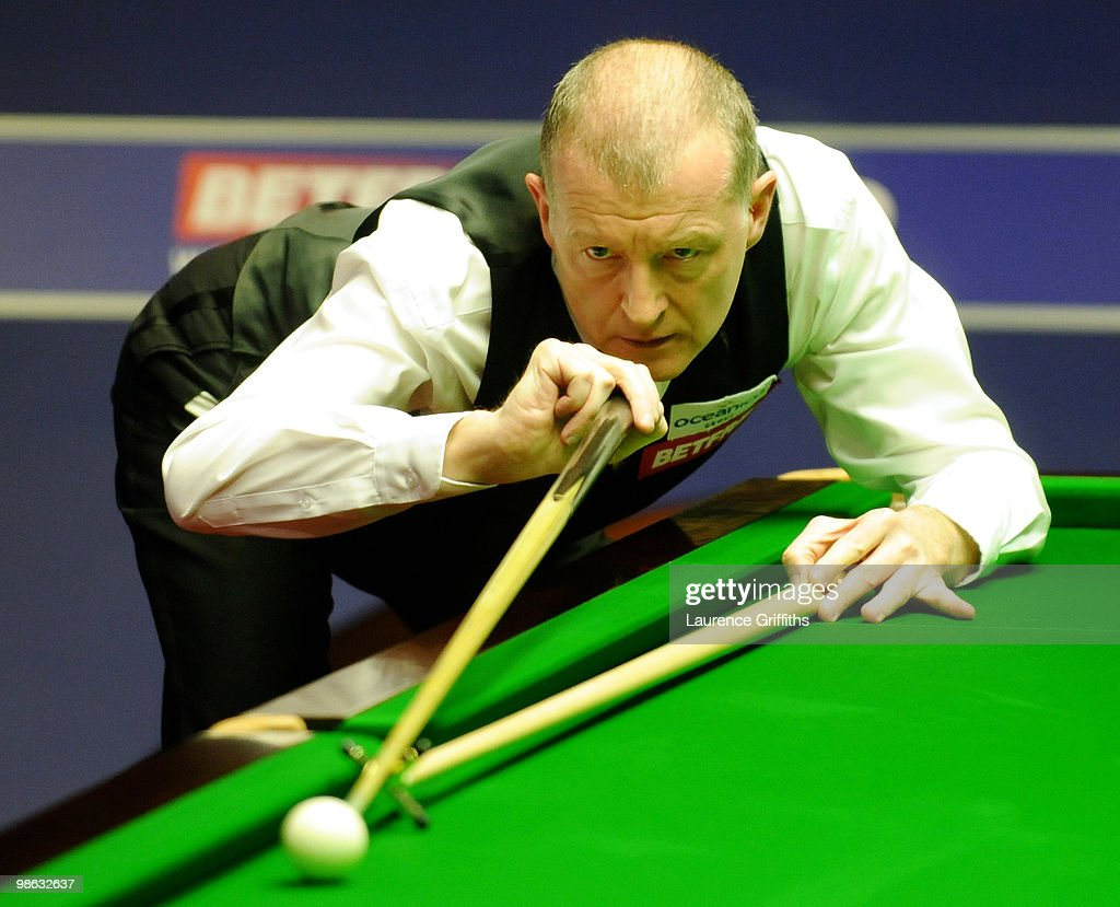 Steve Davis of England takes on a tricky black in his match against John Higgins of Scotland during the Betfred.com World Snooker Championships match at The Crucible Theatre on April 23, 2010 in Sheffield, England.