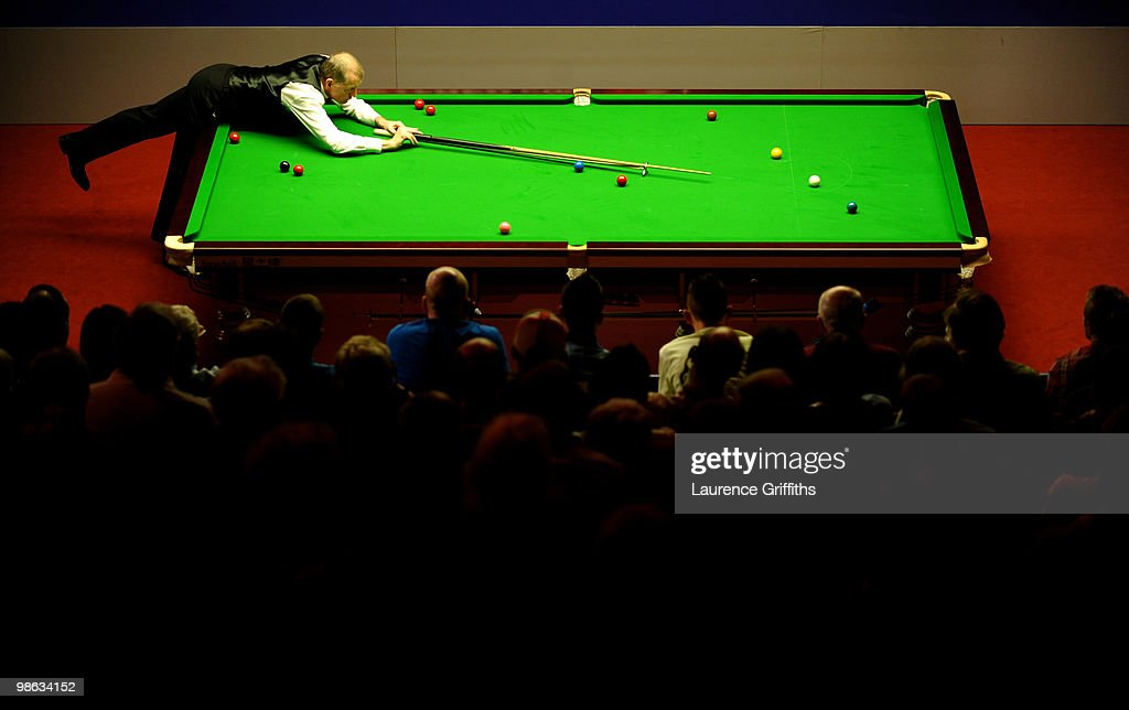 Steve Davis of England takes on a tricky shot in his match against John Higgins of Scotland during the Betfred.com World Snooker Championships match at The Crucible Theatre on April 23, 2010 in Sheffield, England.