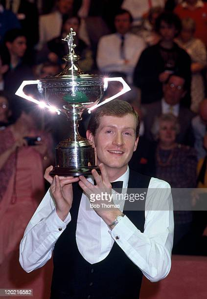 Steve Davis of England winner of the World Snooker Championship after beating Terry Griffiths 1811 with the trophy at the Crucible in Sheffield circa...