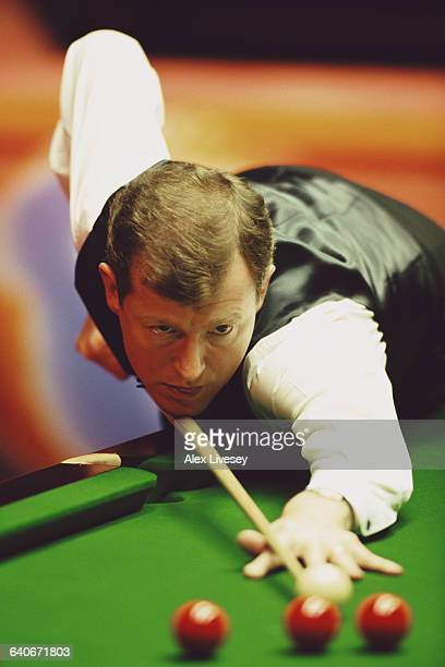 Steve Davis of Great Britain lines up the cue ball during his World Snooker Championship first round match against Simon Bedford on 19 April 1998 at...