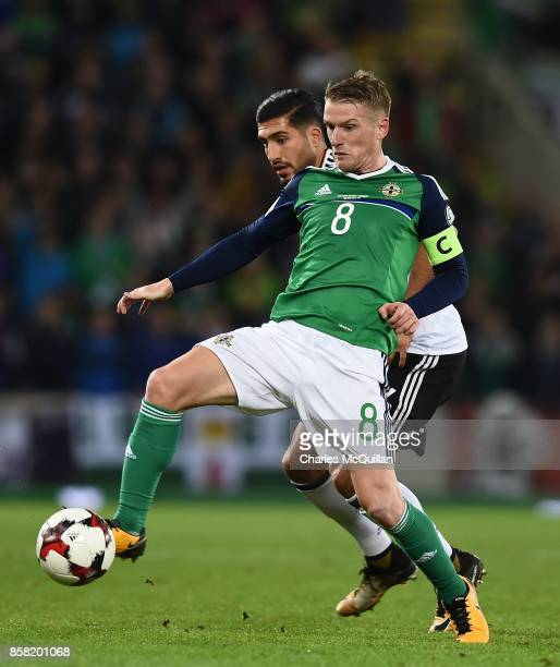 Steve Davis of Northern Ireland and Emre Can of Germany during the FIFA 2018 World Cup Qualifier between Northern Ireland and Germany at Windsor Park...