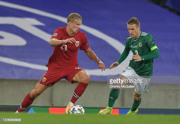 Steve Davis of Northern Ireland and Erling Braut Haaland of Norway during the UEFA Nations League group stage match between Northern Ireland and...