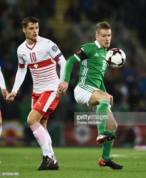 Steve Davis of Northern Ireland and Granit Xhaka of Switzerland during the FIFA 2018 World Cup Qualifier PlayOff first leg between Northern Ireland...