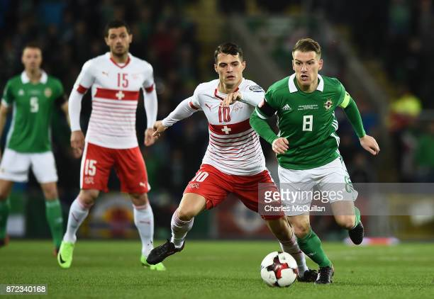 Steve Davis of Northern Ireland and Granit Xhaka of Switzerland during the FIFA 2018 World Cup Qualifier PlayOff first leg between Northern Ireland...