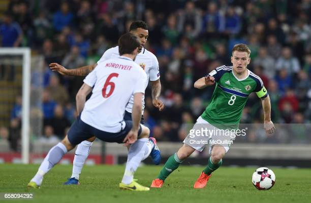 Steve Davis of Northern Ireland and Havard Nordtveit of Norway during the FIFA 2018 World Cup Qualifier between Northern Ireland and Norway at...