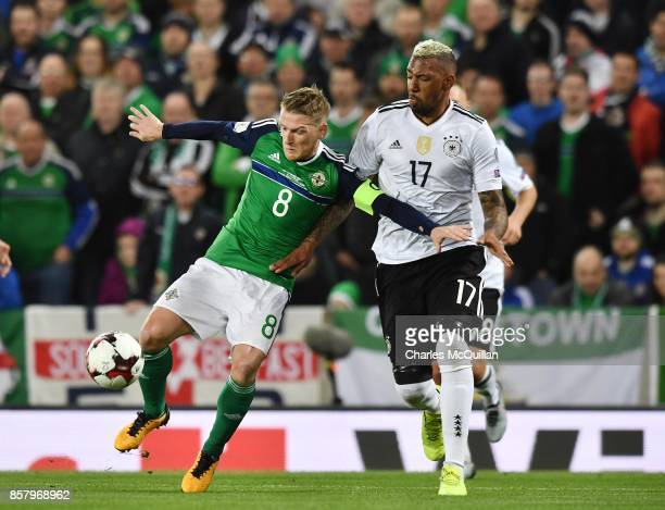 Steve Davis of Northern Ireland and Jerome Boateng of Germany during the FIFA 2018 World Cup Qualifier between Northern Ireland and Germany at...