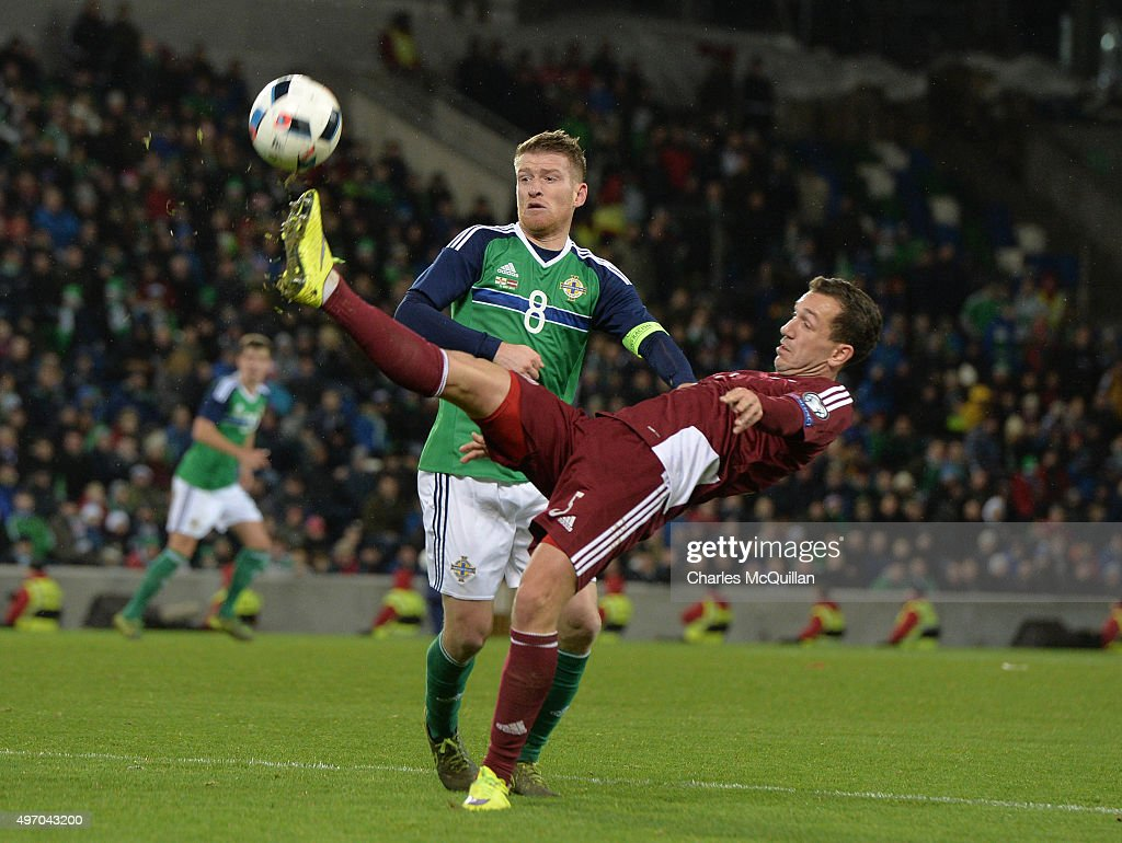 Steve Davis of Northern Ireland (L) and Olegs Laizans of Latvia (R) during the international football friendly at Windsor Park on November 13, 2015 in Belfast, Northern Ireland.