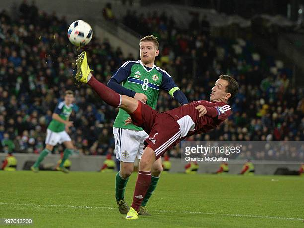 Steve Davis of Northern Ireland and Olegs Laizans of Latvia during the international football friendly at Windsor Park on November 13 2015 in Belfast...