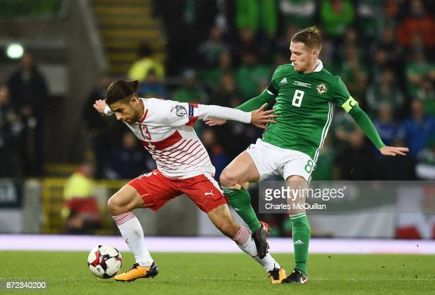 Steve Davis of Northern Ireland and Ricardo Rodriguez of Switzerland during the FIFA 2018 World Cup Qualifier PlayOff first leg between Northern...