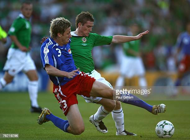 Steve Davis of Northern Ireland battles for the ball with Michael Stocklasa of Leichtenstein during the Euro2008 Group F qualifying match between...