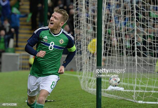 Steve Davis of Northern Ireland celebrates after scoring during the international football friendly at Windsor Park on November 13 2015 in Belfast...