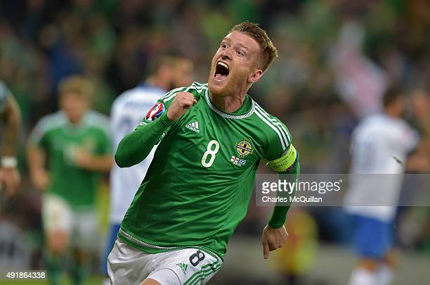 Steve Davis of Northern Ireland celebrates after scoring his side's third goal against Greece during the UEFA EURO 2016 qualifier between Northern...