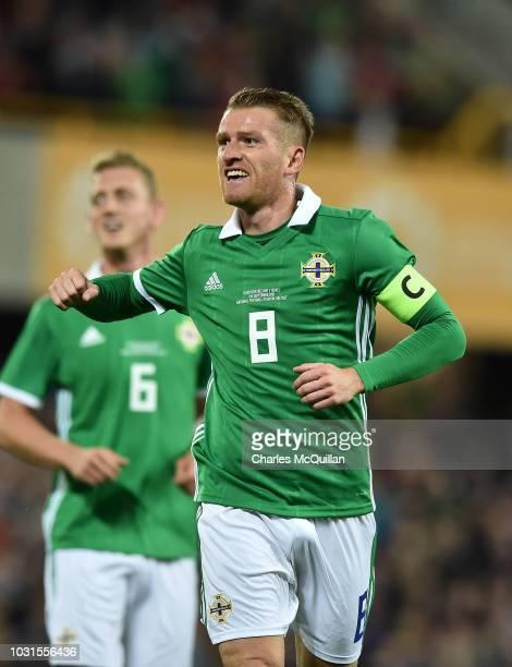 Steve Davis of Northern Ireland celebrates with team mates after scoring during the international friendly football match between Northern Ireland...