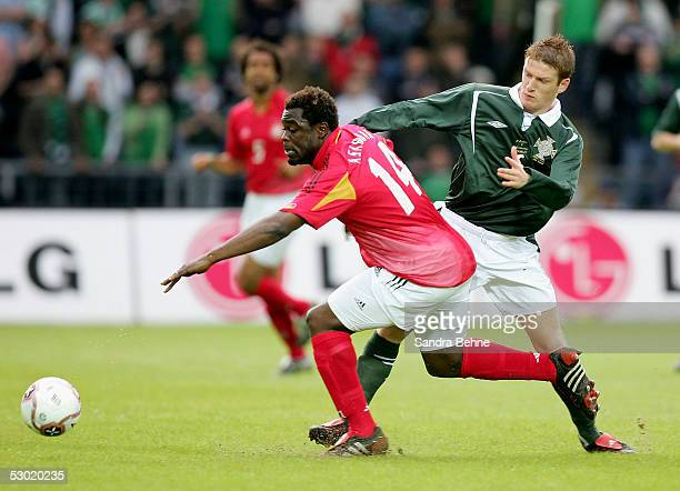 Steve Davis of Northern Ireland challenges Gerald Asamoah of Germany during the friendly match between Northern Ireland and Germany on June 4 2005 in...