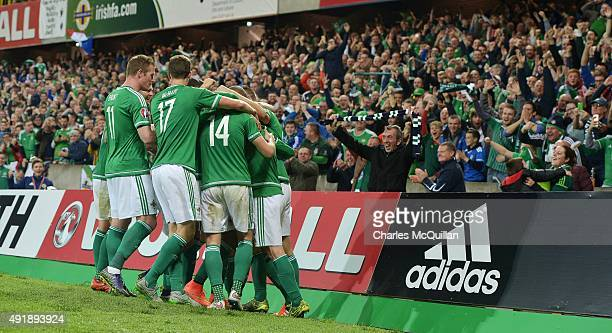 Steve Davis of Northern Ireland is mobbed by team mates after scoring his side's third goal against Greece during the Euro 2016 Group F international...