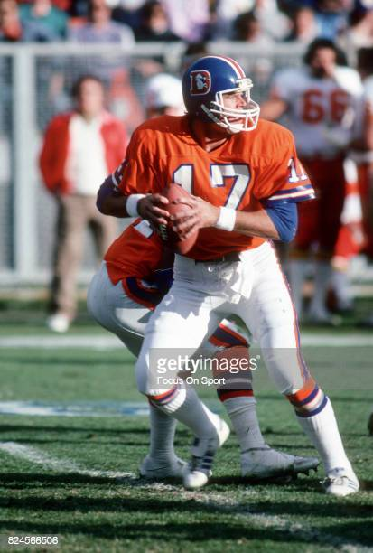 Steve DeBerg of the Denver Broncos drops back to pass against the Kansas City Chiefs during an NFL football game December 19 1982 at Mile High...
