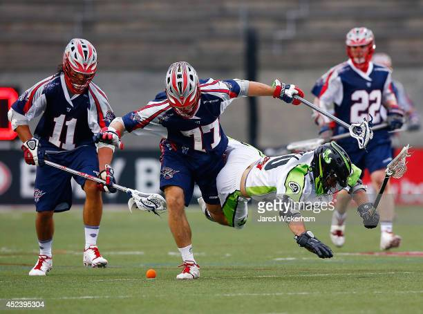 Steve DeNapoli of the New York Lizards is tripped up going for the ball in front of Kyle Sweeney during the game at Harvard Stadium on July 19, 2014...