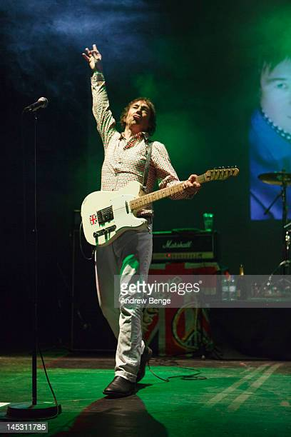 Steve Diggle of Buzzcocks performs on stage at Manchester Apollo on May 25, 2012 in Manchester, United Kingdom.