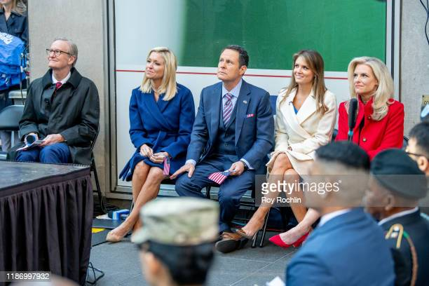 """Steve Doocy, Ainsley Earhardt, Brian Kilmeade and Janice Dean attend the """"Fox & Friends"""" naturalization ceremony for Veterans Day at Fox News Channel..."""
