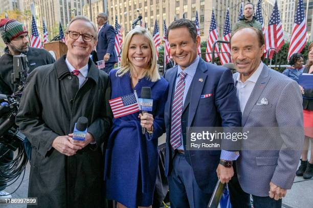 """Steve Doocy, Ainsley Earhardt, Brian Kilmeade with Lee Greenwood attend the """"Fox & Friends"""" naturalization ceremony for Veterans Day at Fox News..."""