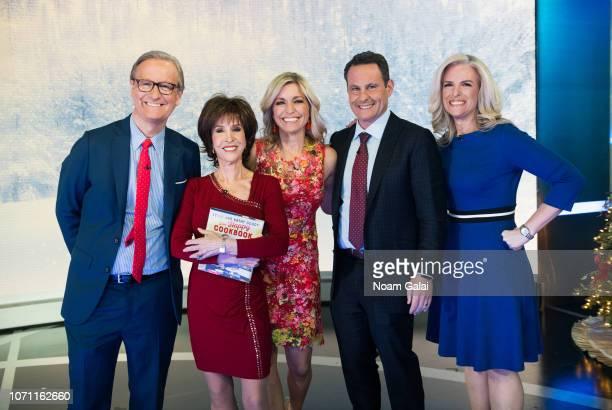 "Steve Doocy, Deana Martin, Ainsley Earhardt, Brian Kilmeade and Janice Dean attend ""FOX & Friends"" at FOX Studios on December 10, 2018 in New York..."