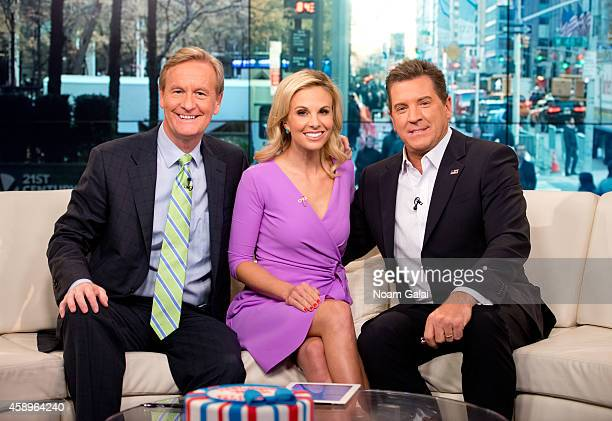 Steve Doocy Elisabeth Hasselbeck and Eric Bolling pose on set as host Elisabeth Hasselbeck returns to FOX and Friends at FOX Studios on November 14...