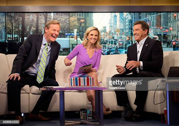Steve Doocy Elisabeth Hasselbeck and Eric Bolling speak on set as host Elisabeth Hasselbeck returns to FOX and Friends at FOX Studios on November 14...