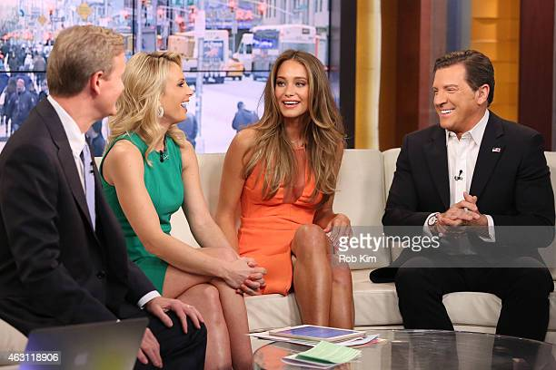Steve Doocy Elisabeth Hasselbeck Hannah Davis and Eric Bolling appear on 'FOX and Friends' at FOX Studios on February 10 2015 in New York City