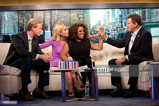 Steve Doocy Elisabeth Hasselbeck Sherri Shepherd and Eric Bolling speak on set as host Elisabeth Hasselbeck returns to FOX and Friends at FOX Studios...