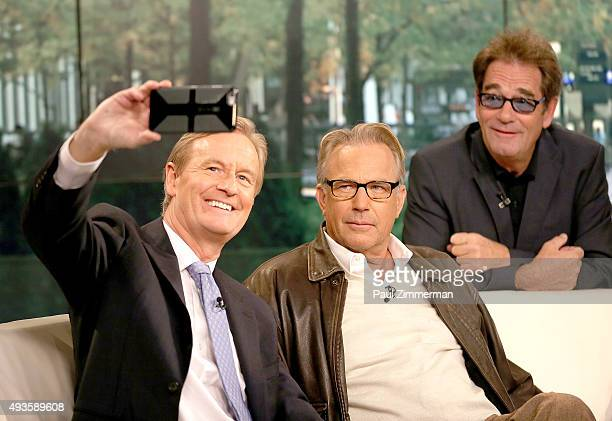 Steve Doocy Kevin Costner and Huey Lewis on set of Fox Friends at FOX Studios on October 21 2015 in New York City