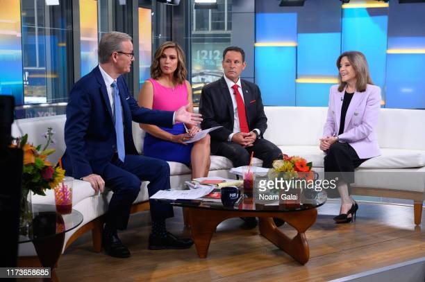 Steve Doocy Lisa Boothe Brian Kilmeade and Democratic presidential candidate Marianne Williamson speak on Fox Friends at Fox News Channel Studios on...