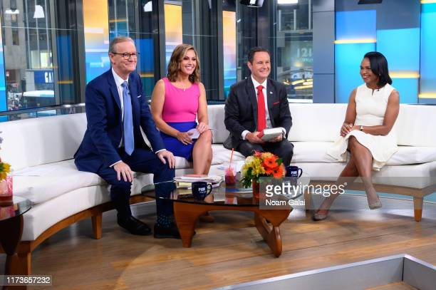 Steve Doocy Lisa Boothe Brian Kilmeade and Former US Secretary of State Condoleeza Rice speak during FOX Friends at Fox News Channel Studios on...
