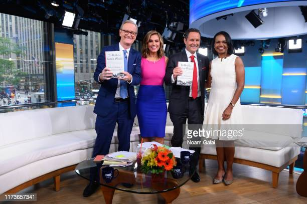 Steve Doocy Lisa Boothe Brian Kilmeade and Former US Secretary of State Condoleeza Rice pose for a photo on the set of FOX Friends at Fox News...