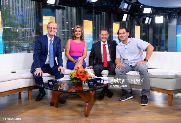 Steve Doocy Lisa Boothe Brian Kilmeade and Johnny Damon speak during FOX Friends at Fox News Channel Studios on September 10 2019 in New York City