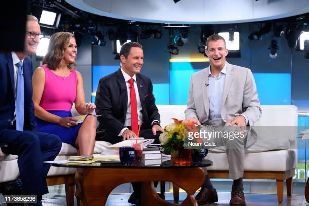 Steve Doocy Lisa Boothe Brian Kilmeade and Rob Gronkowski speak on FOX Friends at Fox News Channel Studios on September 10 2019 in New York City