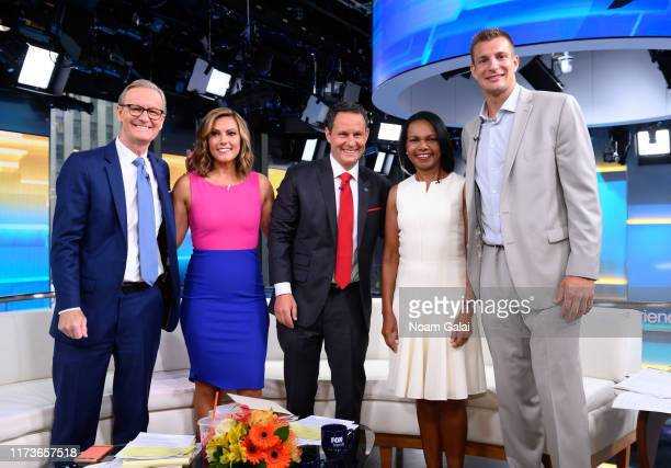 Steve Doocy Lisa Boothe Brian Kilmeade Former US Secretary of State Condoleeza Rice and Rob Gronkowski pose for a photo on the set of FOX Friends at...